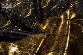 czarna tkanina wyszywana złotą nicią